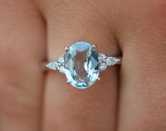 Eidelprecious Mint Campari ring. Mint sapphire engagement ring. Light blue green sapphire 5.3ct oval diamond Campari ring 14k White gold.
