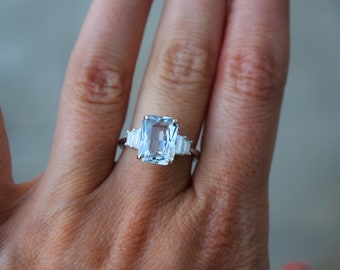 Blue Ice Sapphire Engagement Ring. White gold diamond ring. Emerald cut. Radiant cut. Tapered diamond ring Ice collection by Eidelprecious