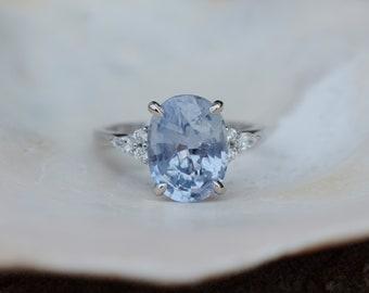 Arctic blue sapphire engagement ring. Color change sapphire ring 5.3ct oval diamond ring Platinum ring. Campari design by Eidelprecious