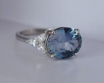 Platinum Storm Sea sapphire engagement ring. Color change sapphire ring 4.8ct oval diamond ring Platinum ring. Trillium ring Eidelprecious