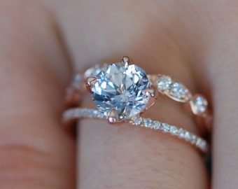 Rose gold engagement ring. 3.1ct round white to ice blue sapphire diamond ring. Double split band ring. Engagement rings by Eidelprecious.