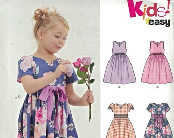 Girls Sewing Pattern New Look 6548 Girls Full Skirt Party Dress with Sash Sleeveless Size 3-8 UNCUT