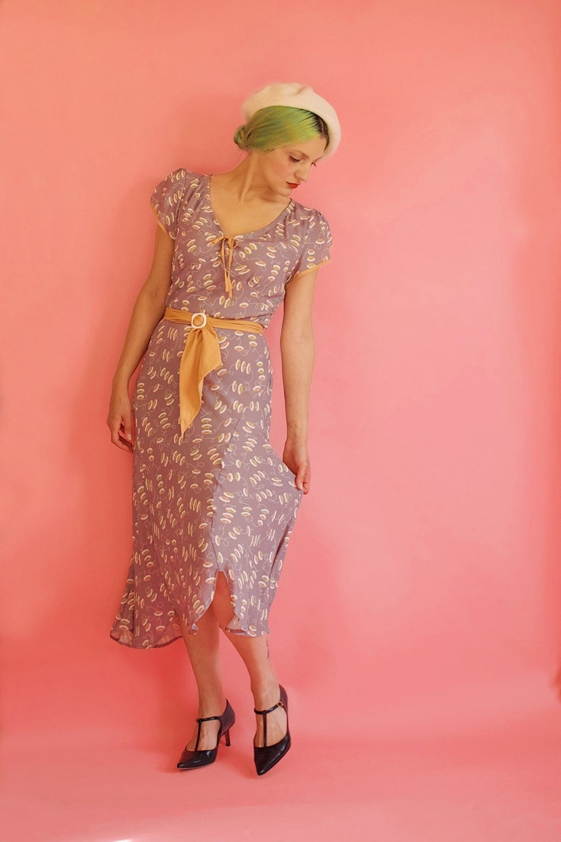 1930s Dresses | 30s Art Deco Dress Mauve Purple Novelty Print 1930s Style Art Deco Day Dress With Scarf Belt and Tulip Sleeves $325.00 AT vintagedancer.com