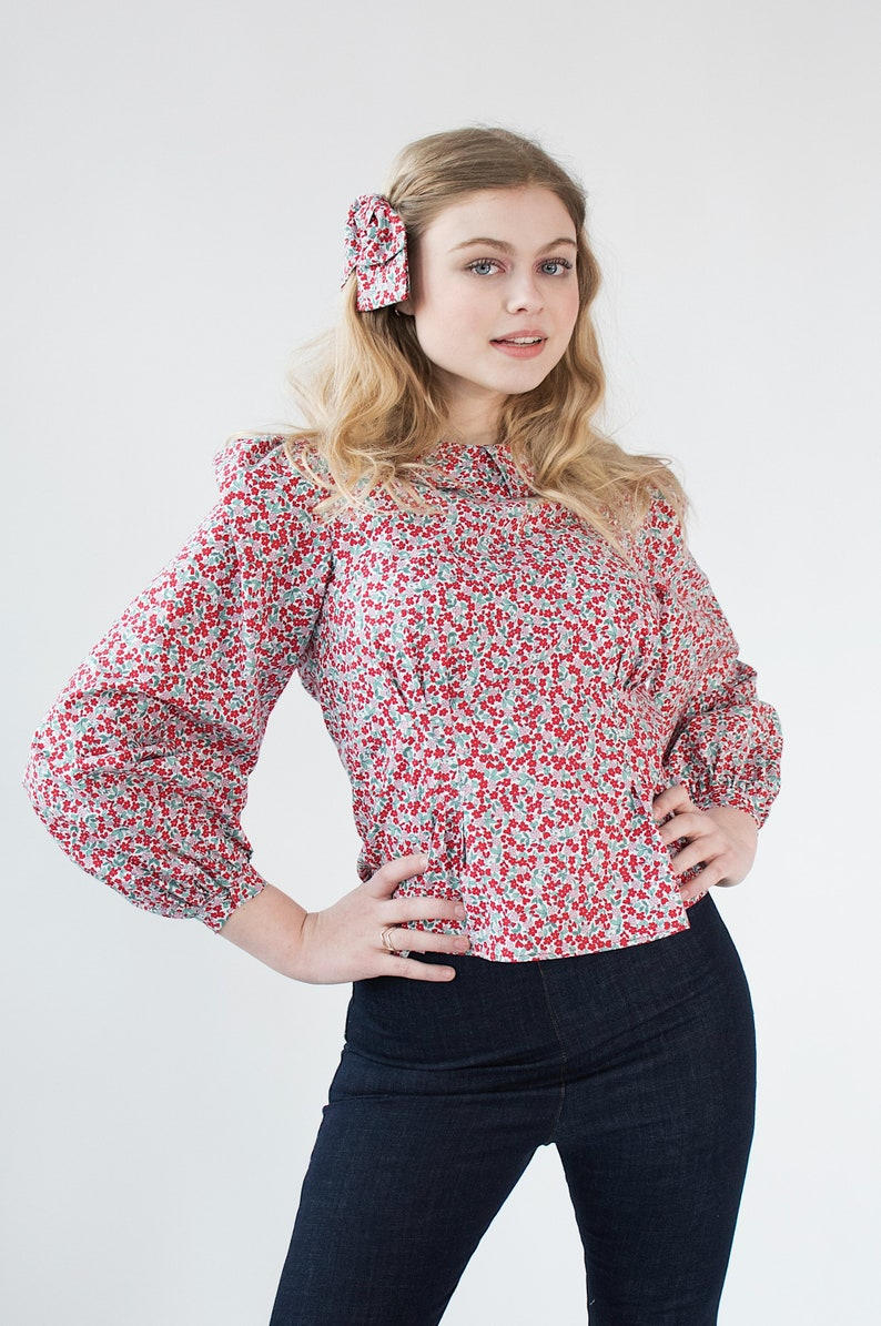 1940s Blouses, Shirts, Knit Tops Fashion History Red and Pink Feed Sack Floral Puff Sleeve 1930s Style Blouse Peter Pan Collar $215.00 AT vintagedancer.com