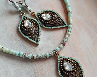 Gemstone and crystal necklace and earrings matching set.