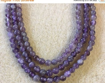 ON SALE Amethyst with Stripes Smooth Gemstone Rounds 4mm 8 inch strand Approx 45 pcs per strand