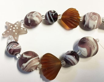 ClearanceMatte Shades of Amethyst Lampwork Glass Beads of the Sea Set of 10 Beads Starfish Scallop Shells Striped Coins Round Swirls