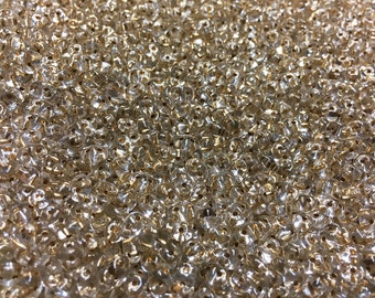 Super Duo Crystal Bronze Lined Czech Pressed Glass Two Hole Seed Beads 2.5mm x 5mm 12 grams