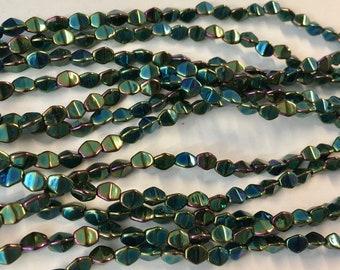 Pinch Beads Green Iris Czech Pressed Glass 5x3mm 50 beads
