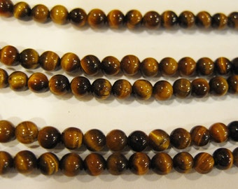 Tigereye 4mm Gemstone Round Beads 8 inch strand