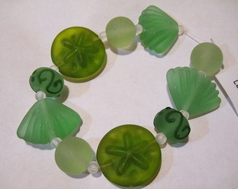 Clearance Matte Shades of Green Lampwork Glass Beads of the Sea Set of 10 Beads Sand Dollar Shells