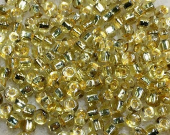 6/0 Chartreuse Peach Crystal Silver Lined Two Toned Rococo Japanese Glass Seed Beads 6 inch tube 28 grams #864
