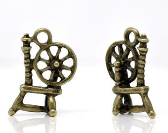 10 Spinning Wheel Charms Double Sided Antique Bronze 18mm x 12mm C179