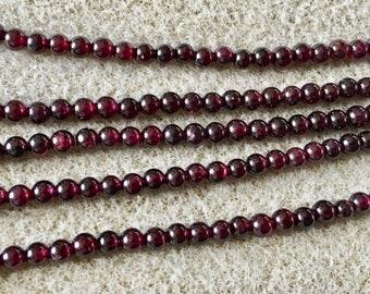 Red Garnet 4mm Gemstone Smooth Round Beads 8 Inch strand Approx 50 beads