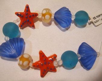 Clearance Matte Shades of Aqua Blue Orange Lampwork Glass Beads of the Sea Set of 10 Beads Starfish Shells or Custom Made Jewelry