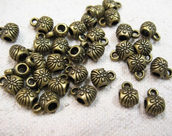 20 Antique Bronze Plated Bail Beads or Charm Holders with Carved Flower Pattern 9mm x 6mm F482