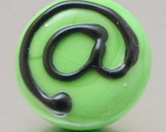 Lapel pin - At sign @ in light green and black. Lampwork glass by Jennie Yip