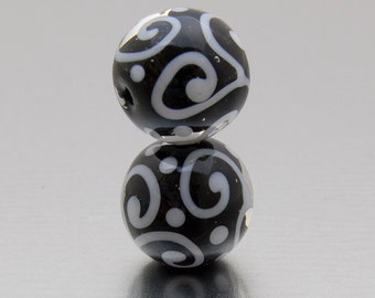 Lampwork glass beads, earring pair. Helix in black and white, by Jennie Yip