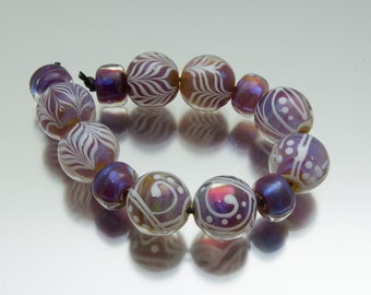 Lampwork bead set: Keep Breathing in kalypso and white. Lampwork by Jennie Yip