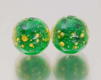 Lampwork glass beads, earring pair. Shimmer in emerald green, by Jennie Yip