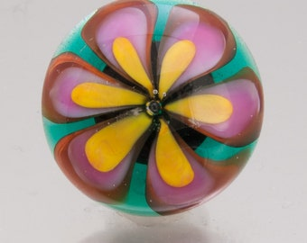 """Glass button: """"Floating Flower""""  in green, pink and apricot yellow, with a copper shank. Lampwork glass by Jennie Yip"""