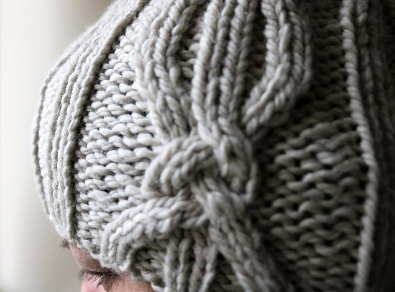 Chunky hand knit rib hat with cable and twist design.