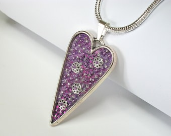 """ART PENDANT: """"Where the Heart Is"""""""" Lavishly embroidered art piece necklace with applique, beads and sterling silver chain.  Handmade."""