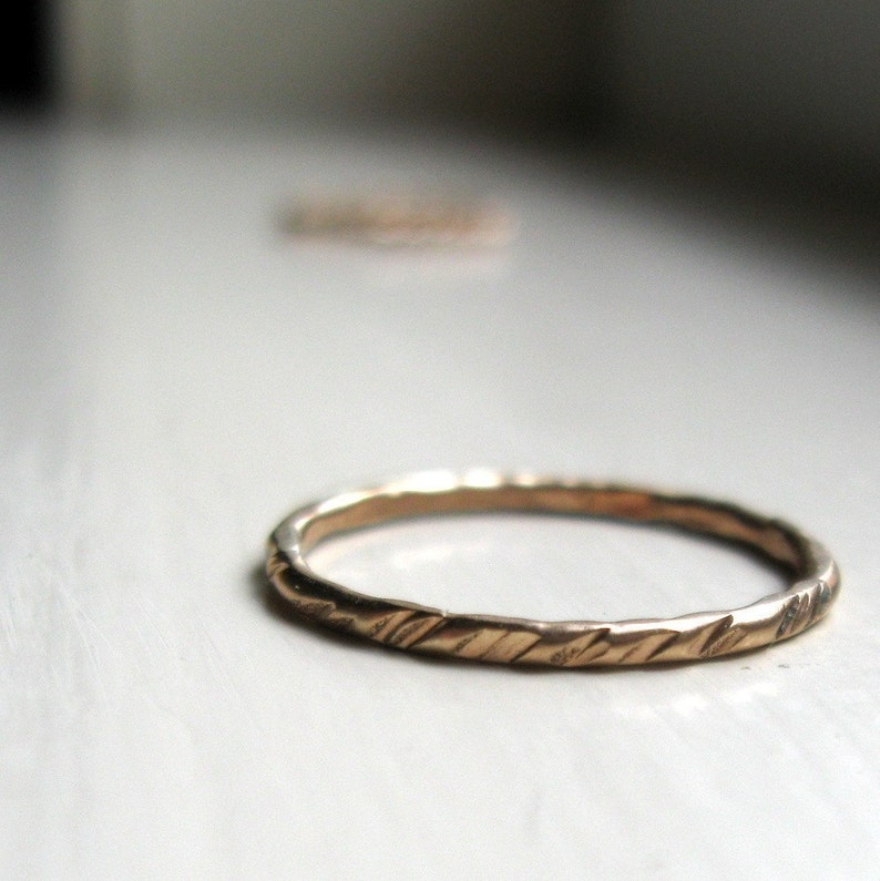 Rustic textured gold stacking ring image 0