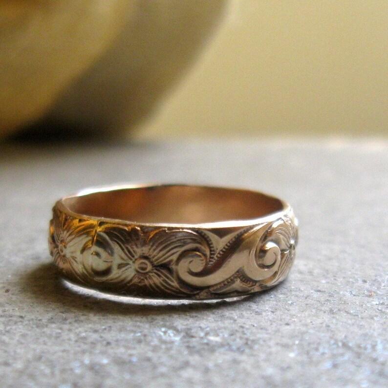 Gold floral pattern ring image 0