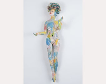 """Ceramic Art wall sculpture. """"The burden of a gift"""" Colorful Mixed media female figure."""
