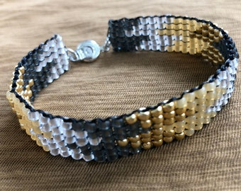 hand-loomed square stitch African pattern gray, gold, silver, opal yellow beaded cuff bracelet with snap clasp
