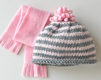 American Girl doll hand-knit hat and scarf set. Hat is pink & gray striped wool w/ fleece pom pom. Coordinating scarf in pink fleece.