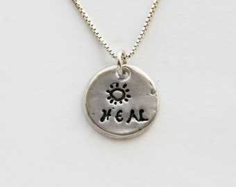"""Heal Necklace, fine silver Small sun Heal charm on sterling silver chain, length options, individually handmade charm with sun and """"heal"""""""