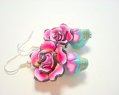 Sugar Skull Earrings Turquoise and Pretty Pink Heart Eyes Day of the Dead Roses and Skulls