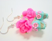Sugar Skull Earrings Turquoise and Bright Pink Flower Eyes Day of the Dead Roses and Skulls