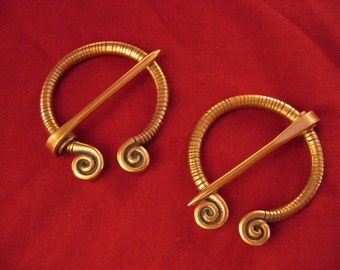 Pair of Spiral Penannular Brooches