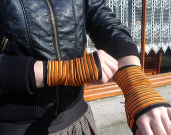 Mitaine-short cuff with orange/yellow and black stripes in Lycra. Retro style. Empty workshop balance