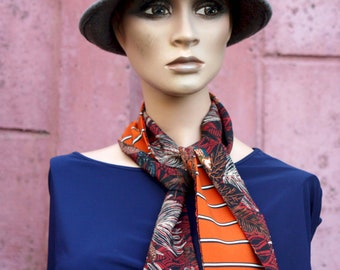Long orange scarf with black and white stripes and black brown foliage patterns, retro woman lavallière in Viscose and acetate. scarf to tie.