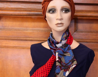 Scarf woman with flowers and polka dots, red blue and black. Slice of wool
