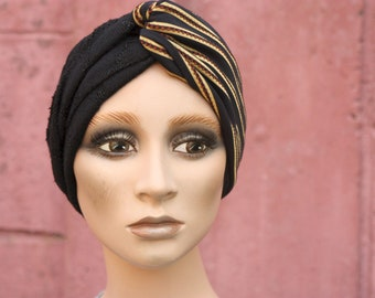 Black Hair Band and Golden Stripes. Wool and Lycra. Turban twist woman hairstyle.