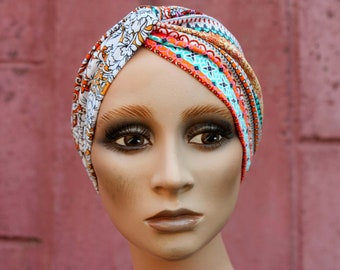 Headband-Turban in lycra jersey with brown-white-pink-orange ethnic patterns on a white background. Headband woman hair.