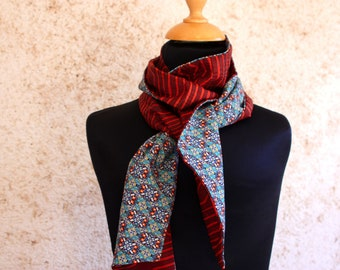 Scarf woman brick orange and turquoise kaleidoscope patterns. Slice of wool. Woman accessory