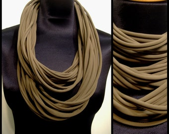 Promo Studio space. Collar/necklace in khaki green Lycra fabrics. Stretch fabric Choker