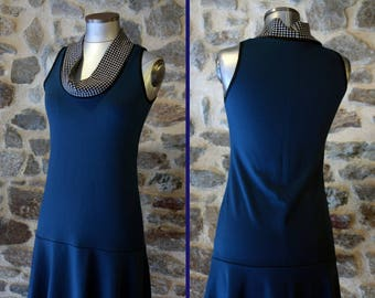 Promo Studio space. Dress blue / black collar and white Houndstooth. Creative woman Jersey dress