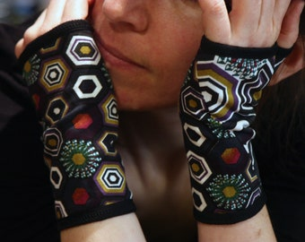 Cotton Mitt to Kaleidoscope patterns. Multicolor woman mitten gloves. Slice of wool