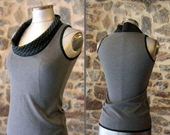 Woman Tee-Shirt, tank top sleeveless sweater is black with grey polka dot collar. Mid season Jersey cotton.