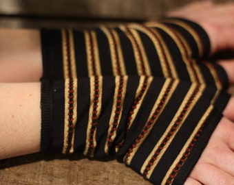 Glove's black and gold stripe in lycra, cotton lining. Mittens women gloves. Slice of wool