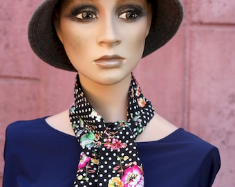 Black woman lavallière scarf with white polka dots and multicolored flowers in cotton and silk. Laine silk scarf tartine