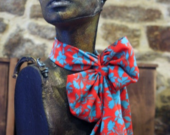 Red woman with flowers and blue butterfly scarf viscose crepe. Slice of wool.