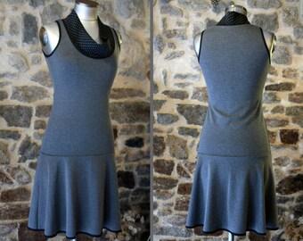 Promo Studio space. Dress gray mouse polka dot black and gray Italian Jersey. Two-tone dress